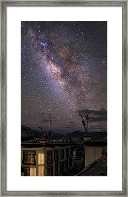 The Milky Way Over A Small Vilage Framed Print by Jeff Dai
