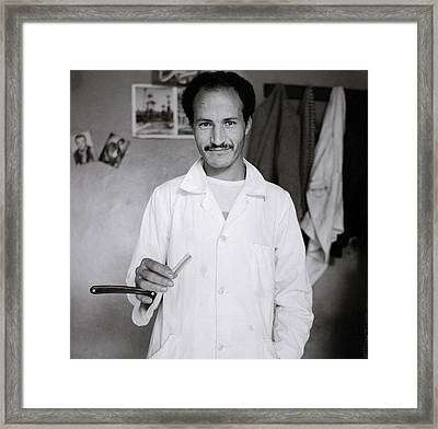 The Moroccan Barber Framed Print by Shaun Higson