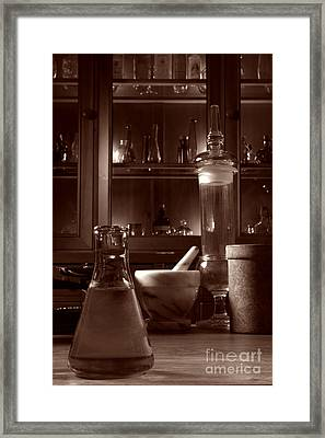 The Old Apothecary Shop Framed Print by Olivier Le Queinec