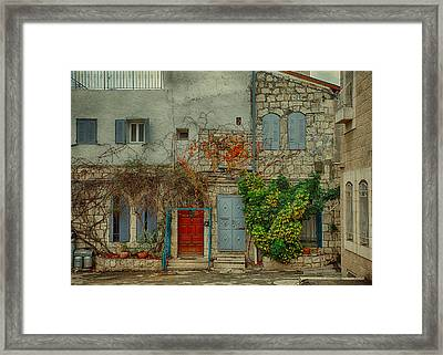 Framed Print featuring the photograph The Old Courtyard by Uri Baruch