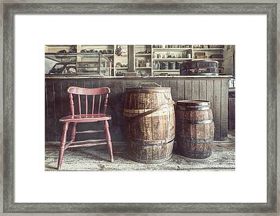 The Old General Store - Red Chair And Barrels In This 19th Century Store Framed Print