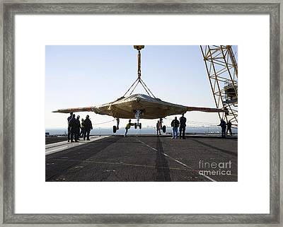 The Onload Of The X-47b Unmanned Combat Framed Print by Stocktrek Images