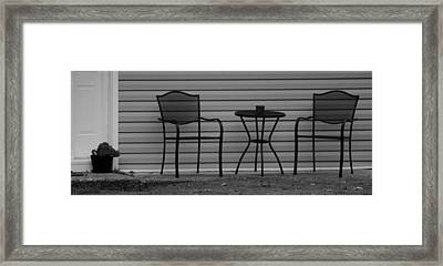The Patio Chairs In Black And White Framed Print by Rob Hans