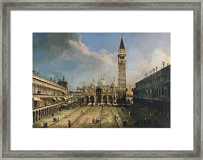The Piazza San Marco In Venice Framed Print by Canaletto