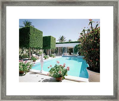 The Pool And Garden Of A Home Framed Print