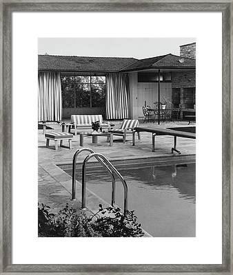 The Pool And Pavilion Of A House Framed Print by Sharland