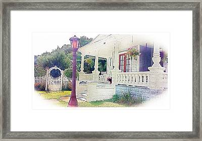 The Porch Lamp Post And The Gate Framed Print