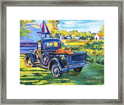 The Pumpkin Pickup Framed Print by David Lloyd Glover