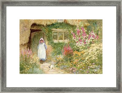 The Puppy Framed Print by Arthur Claude Strachan