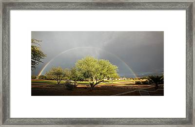 The Rain And The Rainbow Framed Print