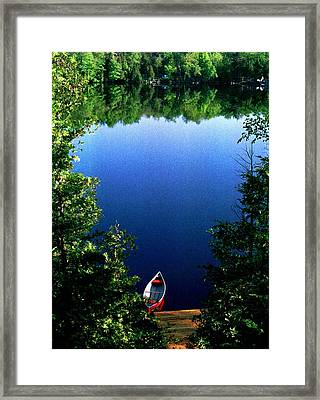 The Red Canoe Framed Print