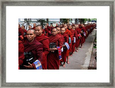 The Red Line Of Buddhist Monks Framed Print