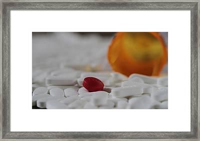 The Red Pill Framed Print