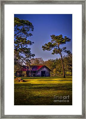 The Red Roof Barn Framed Print by Marvin Spates