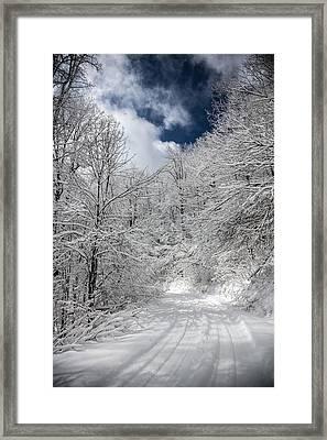 The Road To Winter Wonderland Framed Print by John Haldane