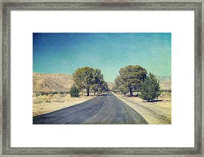 The Roads We Travel Framed Print