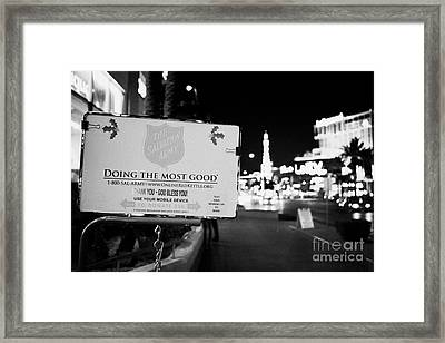 the salvation army christmas collection point on the Las Vegas boulevard Nevada USA Framed Print by Joe Fox