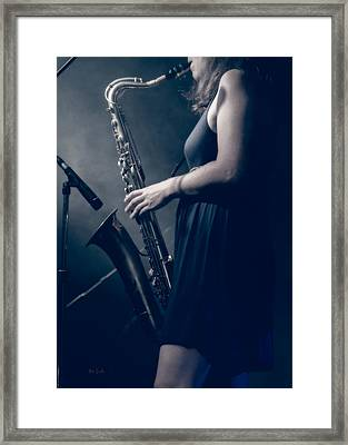 The Saxophonist Sounds In The Night Framed Print by Bob Orsillo