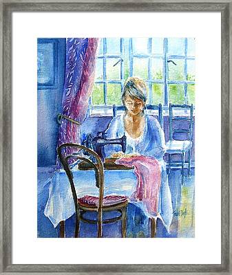 The Seamstress Framed Print