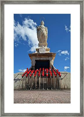 The Shrine To St Raphael At Whose Feet Framed Print
