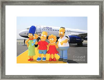 The Simpsons Are Ready To Board Their Plane Framed Print