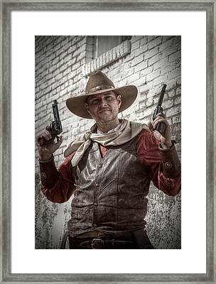 The Six Shooter Framed Print by Linda Unger