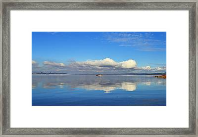 The Sky The Lake And The Boat Framed Print by Rima Biswas