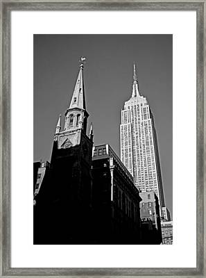 The Skyscraper And The Steeple Framed Print