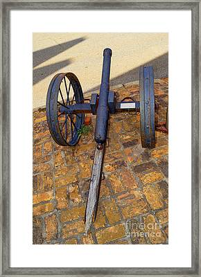 The Small Cannon Outside On The Sidewalk In Downtown Andersonville Georgia Framed Print