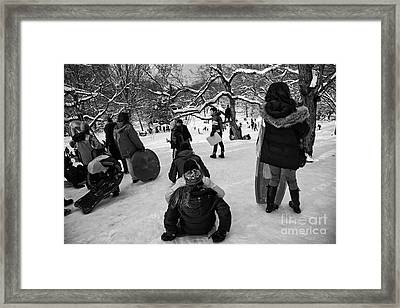 The Snowboarders Framed Print