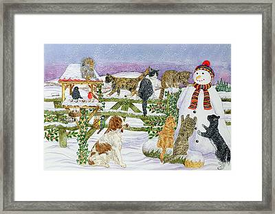 The Snowman And His Friends  Framed Print