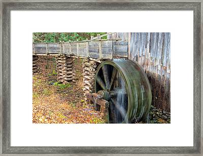 The Spinning Water Wheel Framed Print