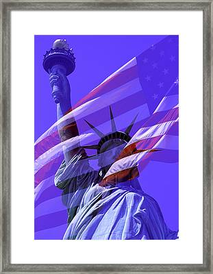 The Statue Of Liberty Draped With The Flag Of The United States Framed Print