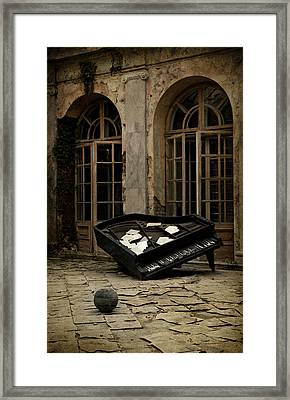 The Stone Sphere And Broken Grand Piano Framed Print