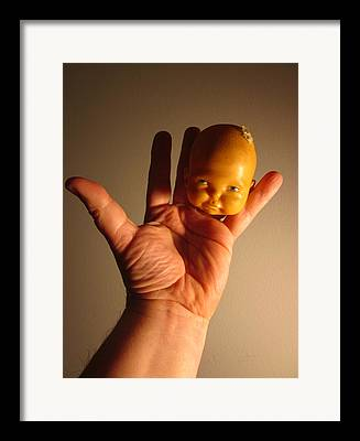 A Head Of A Doll And A Hand And Fingers As Body Make Up A Very Odd And Framed Prints