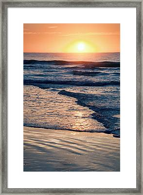 Sun Rising Over The Beach Framed Print