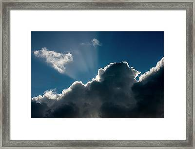 The Sunlight Hides Behind The Clouds Framed Print by Robert L. Potts