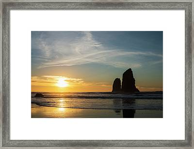 The Sunset With Silhouettes Of Rock Framed Print
