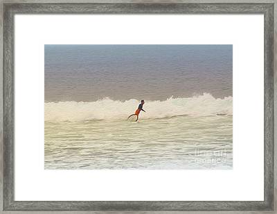The Surfer Framed Print by Nur Roy