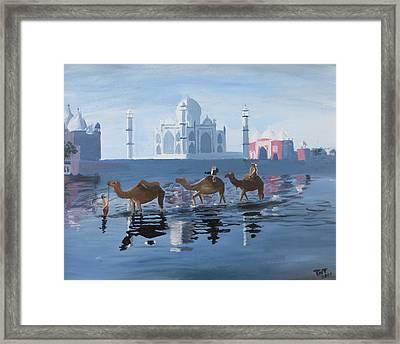 The Taj Mahal And The Yamuna River Framed Print