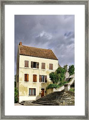 The Tall Yellow House By The Old Stairway Framed Print by Olivier Le Queinec