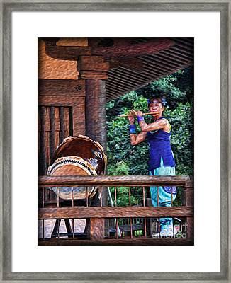 The Temple Flutist Framed Print by Lee Dos Santos