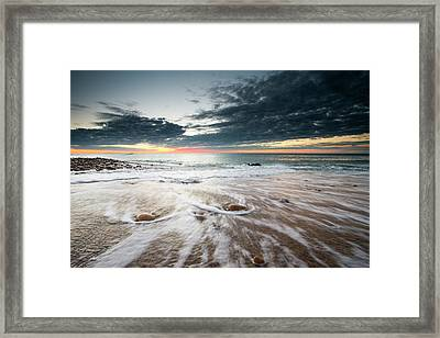 The Tide Ebbs Under The First Rays Framed Print