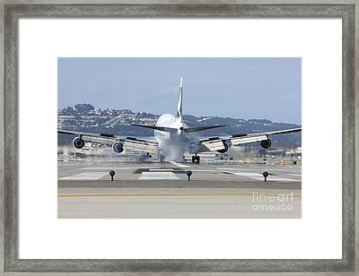 Framed Print featuring the photograph The Touchdown by Alex Esguerra