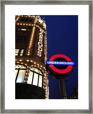 The Underground And Harrods In London Framed Print