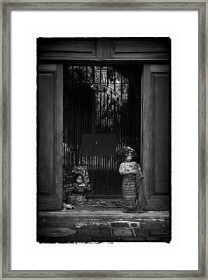The Vendor Children Framed Print by Tom Bell