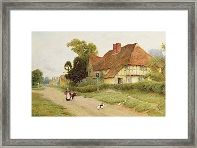 The Village Inn Framed Print by Arthur Claude Strachan