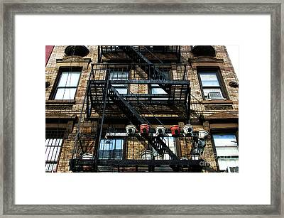 The Village Framed Print by John Rizzuto
