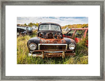 The Volvo Junkyard Framed Print by Dale Kincaid