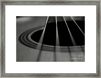 The Warmth Of Strings Framed Print